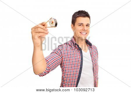Joyful guy holding a piece of sushi with Chinese sticks and looking at the camera isolated on white background