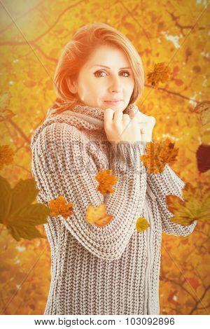 Pretty girl in jumper against autumn scene