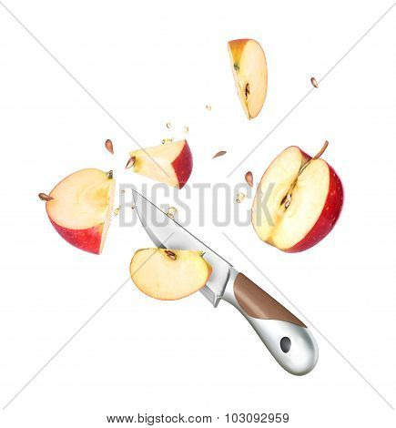 A Knife And An Apple Cut In Half Are Frozen In Mid Air