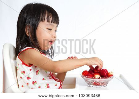 Asian Chinese Little Girl Eating Strawberries