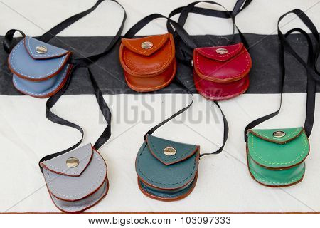 Closeup Collection Of Color Leather Small Pocket Purse.