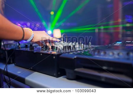 DJ mixing music on console