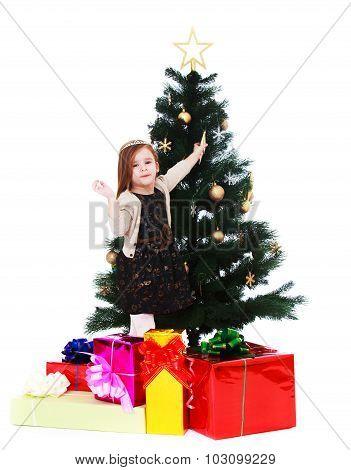 little girl dresses up Christmas tree