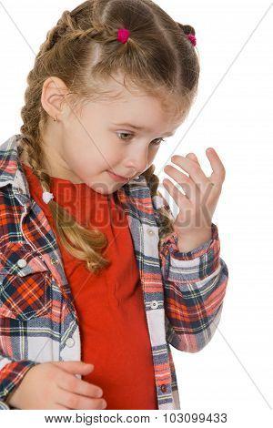 little girl wipes her tears