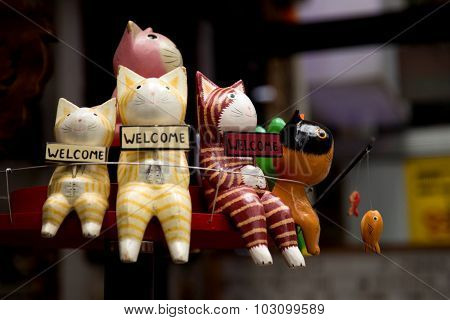 Cats with Welcome sign