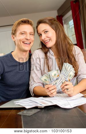 Happy young couple with a lot of cash