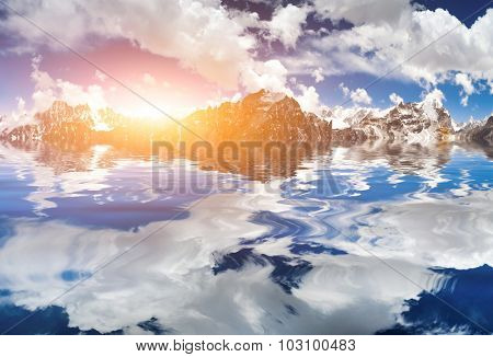 Beautiful mountains view with reflection in water in sunrise with blue sky and white clouds