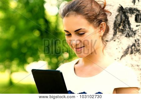 Smiling young woman with digital tablet. Photo with instagram style filter