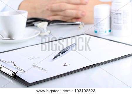 Prescription With A Pen. Doctor With Pills  On A Background