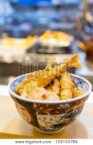Tempura served over a bowl of rice
