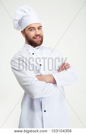 Portrait of a happy male chef cook standing with arms folded isolated on a white background