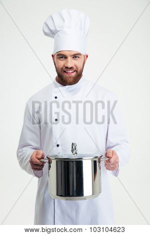 Portrait of a male chef cook holding pan isolated on a white background