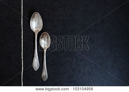 Two silver spoons with pearls