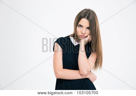 Portrait of a bored woman looking at camera isolated on a white background