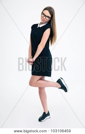 Full length portrait of a charming woman posing isolated on a white background