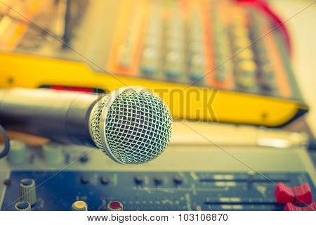 Microphone and Music mixer desk with various knobs ( Filtered image processed vintage effect. ) ( Filtered image processed vintage effect. )