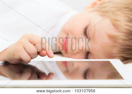 Little boy with touch pad, modern technology
