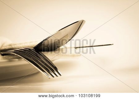 Vintage Color Of Close Up Dinning Silverware Fork , Spoon And Knife With Dish On White Background An