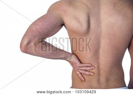 Midsection of a man undergoing back pain over white background