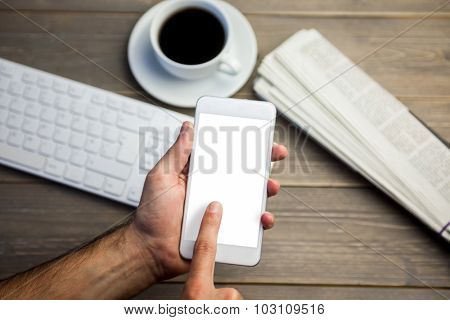 Person using mobile phone at the desk