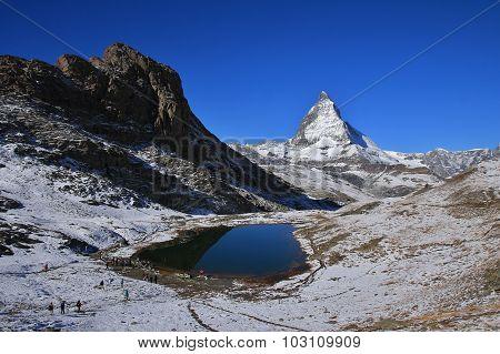 Lake Riffelsee And Matterhorn In Autumn