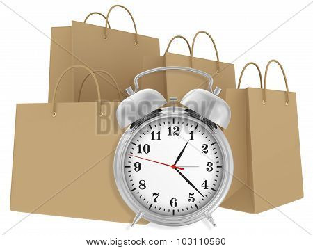 Alarm clock with paper bags isolated on white background