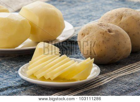 sliced raw potato on kitchen table