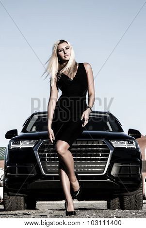 Gorgeous Lady At The Background Of The Luxury Car