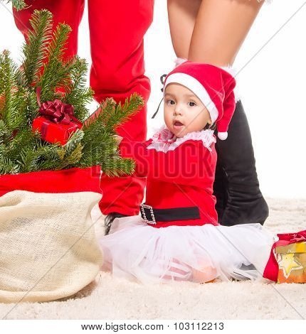 Beautiful baby girl in front of the christmas tree