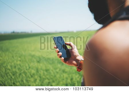 Mock up of bearded man looking in his smartphone
