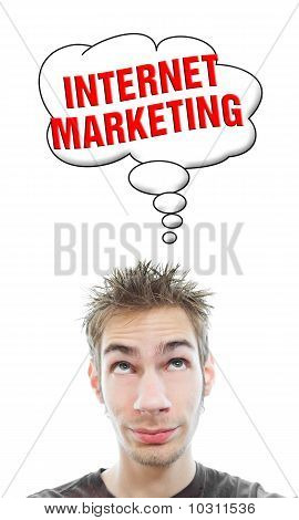 Young Man Thinks About Internet Marketing