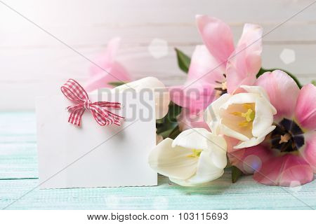 Postcard With Fresh Spring Flowers And Empty Tag For Your Text