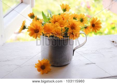 Bouquet of yellow flowers in the iron mug