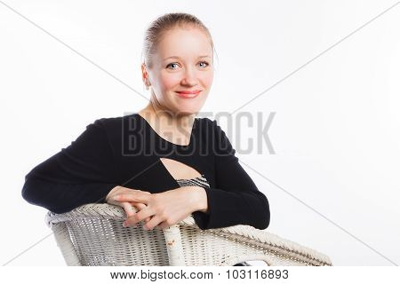 Happy woman resting on arm-chair