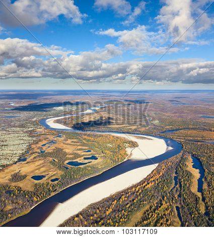forest-tundra river in autumn, top view