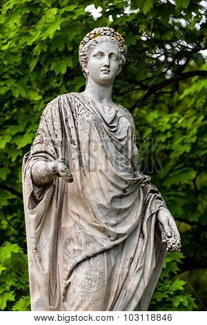 Marble statue of roman Ceres or greek Demeter in the park of the Palace and park complex Estate of G. Galagan. Sokyryntsi village, Ukraine