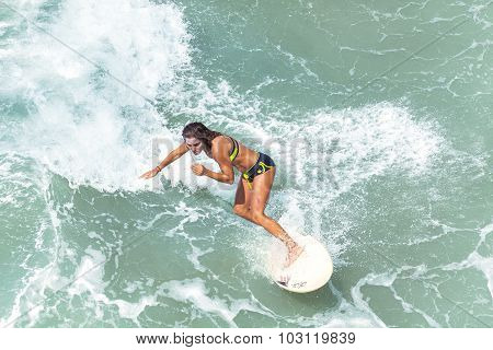 Young Woman Surfing At Venice Beach.