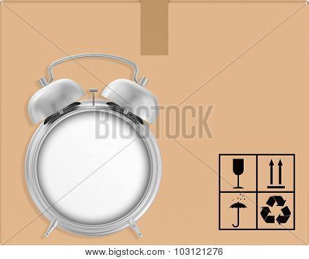 background cardboard box with alarm clock.