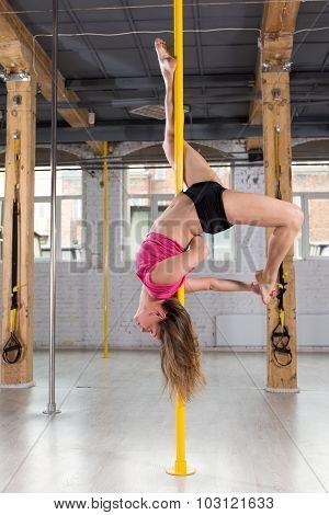 Girl Doing Acrobatics On Pole