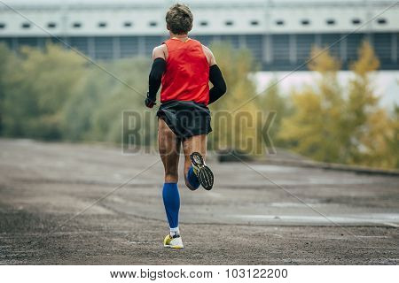 young runner running across street