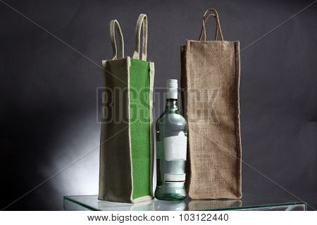 Bag For Water Or Alcohol Made Out Of Recycled Hessian Sack With Bottle