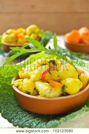 Cauliflower curry with pumpkin, paprika and arugula