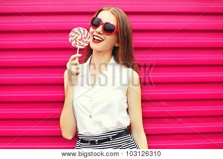 Sweet Pretty Young Woman With Lollipop Over Pink Background