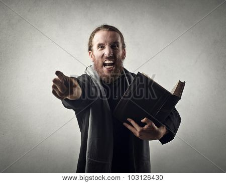 Angry priest doing a sermon