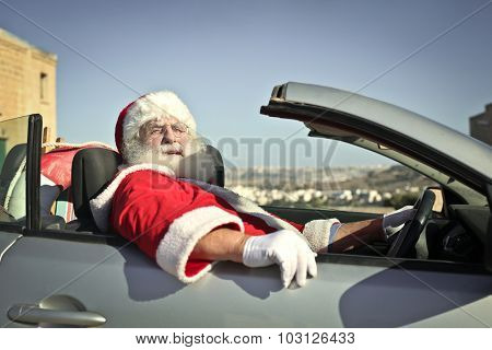 Santa Claus driving his car