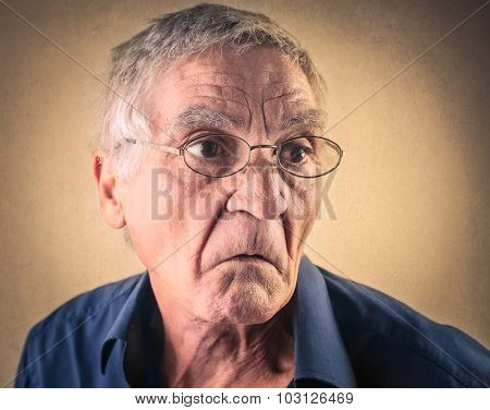 Disappointed elderly man