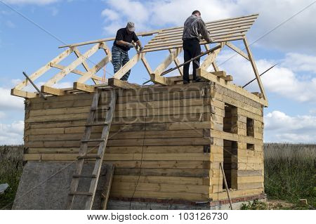Mstera,Russia-September 14,2015:Construction of the new premises from tree in field on background bl