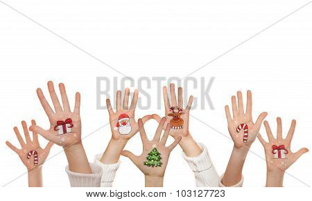 Christmas symbols painted on kid's hands. Santa, snowman, Christmas tree, present box, reindeer etc
