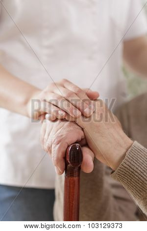 Kind Caregiver Holding Senior Man