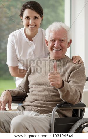 Old Man Sitting On Wheelchair